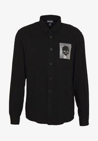 Just Cavalli - SHIRT SPARKLY SKULL - Košile - black - 4