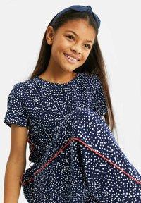 WE Fashion - MET STIPPENDESSIN - Jumpsuit - dark blue - 1