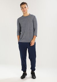 Under Armour - SPORTSTYLE - Tracksuit bottoms - academy - 1
