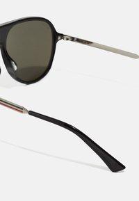 Gucci - Occhiali da sole - black - 4