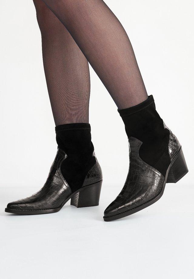 Korte laarzen - schwarz 007