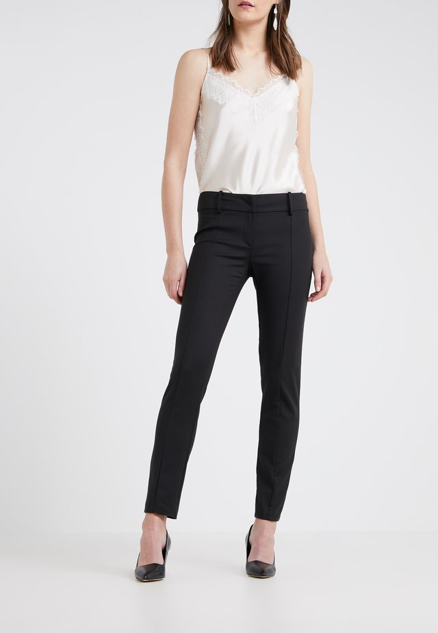 TROUSERS - Pantalones - nero