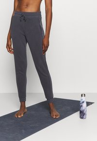 Free People - BACK INTO IT  - Tracksuit bottoms - black - 0