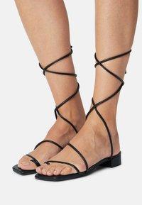 Monki - T-bar sandals - black - 0