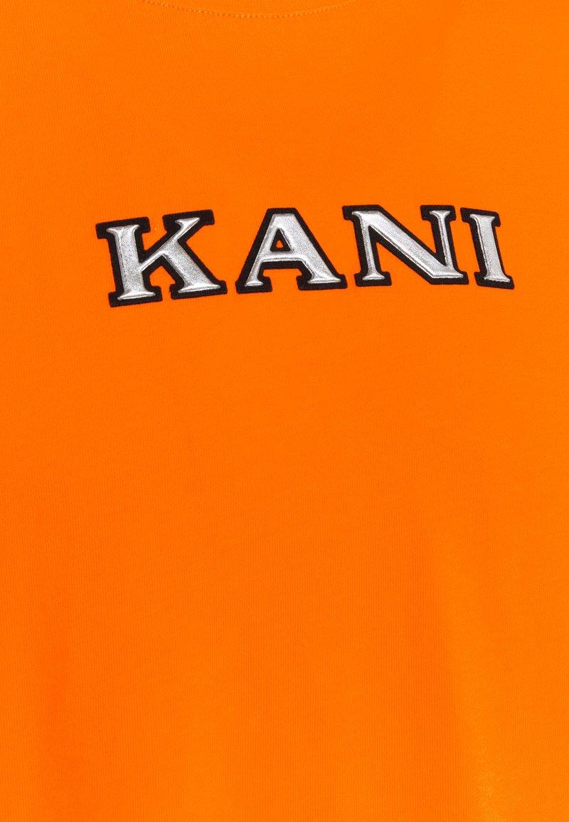 Karl Kani RETRO TEE - T-Shirt print - orange nutcxj