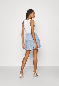 NA-KD - PAMELA REIF X ZALANDO RECYCLED FRILL MINI SKIRT - Mini skirt - painted blue - 2