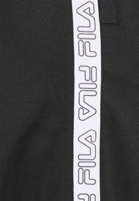 Fila - JAIRUS TAPE TRACK PANTS - Tracksuit bottoms - black - 2