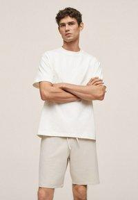 Mango - FUNCHAL - Shorts - open beige - 0