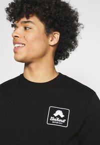 Carhartt WIP - PEACE STATE  - Print T-shirt - black / white - 6