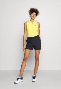 Peak Performance - TURF ZIP  - Polo shirt - citrine - 1