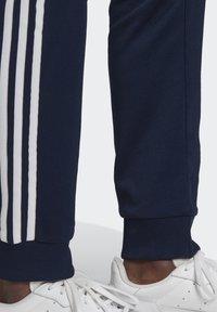 adidas Originals - ADICOLOR CLASSICS PRIMEBLUE SST TRACKSUIT BOTTOM - Spodnie treningowe - blue - 5