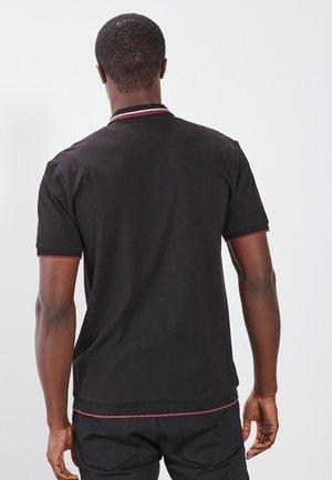 BUTTON THROUGH POLO - Shirt - black