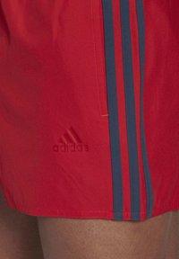 adidas Performance - CLASSIC 3-STRIPES SWIM SHORTS - Swimming shorts - red - 3