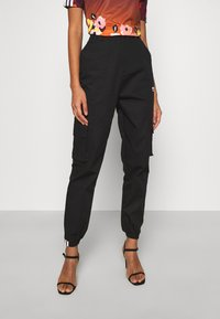 adidas Originals - PANT - Cargo trousers - black - 0