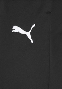 Puma - TEAMRISE TRAINING PANTS - Joggebukse - black/white - 2