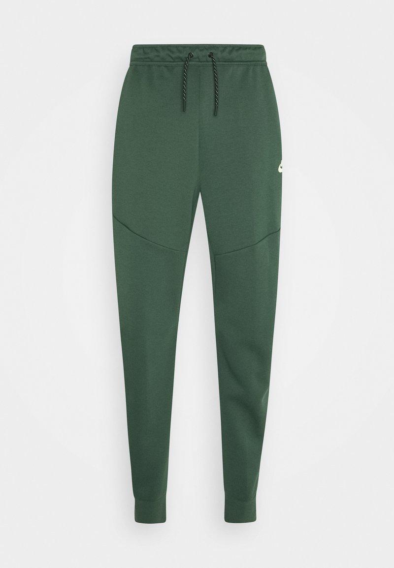 Nike Sportswear - M NSW TCH FLC JGGR - Pantaloni sportivi - galactic jade/light liquid lime
