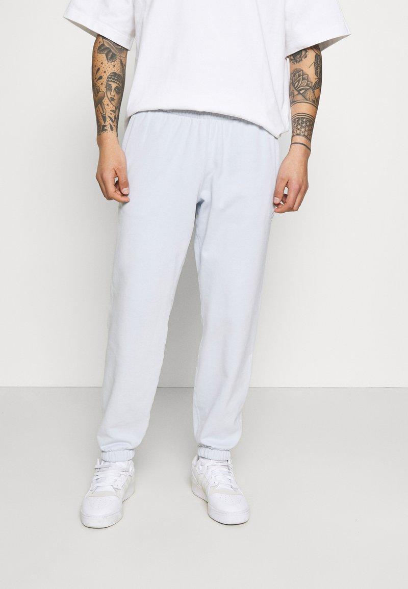 adidas Originals - PREMIUM UNISEX - Träningsbyxor - halo blue