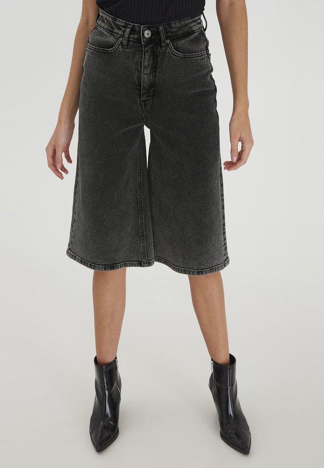 Jeans a zampa - washed black