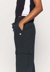 Champion - ELASTIC CUFF PANTS LEGACY - Trainingsbroek - black - 4