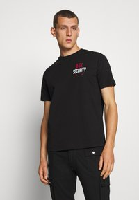 Diesel - T-JUST-N41 T-SHIRT - Camiseta estampada - black - 0