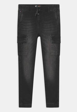 SALKI - Cargo trousers - exblac