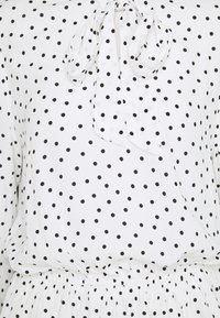 Marks & Spencer London - SPOT PEPLUM TOP - Long sleeved top - off-white - 2
