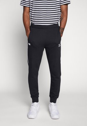 Nike Sportswear DNA French-Terry-Jogger für Herren - Tracksuit bottoms - black/white
