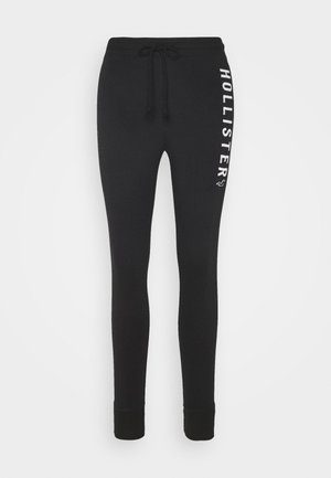 TIMELESS - Tracksuit bottoms - black