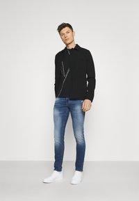 Armani Exchange - Jeans slim fit - indigo denim - 1