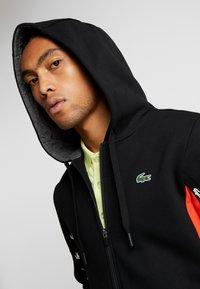 Lacoste Sport - veste en sweat zippée - black/corrida/pitch chine - 4