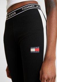 Tommy Jeans - METALLIC BLOCK - Leggings - black - 5