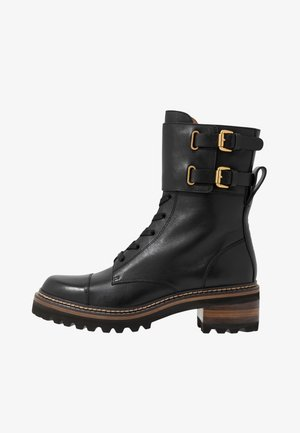 Kotníkové boty na platformě - texan nero