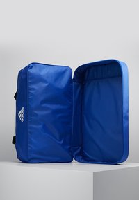 adidas Performance - TIRO DU - Sports bag - bold blue/white - 5