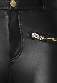 ONLY Petite - ONLHENRIETTA - Trousers - black - 5