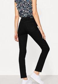 edc by Esprit - HIGH SKIN PANTS DENIM - Slim fit jeans - black denim - 2