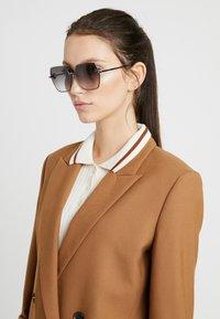 Alexander McQueen - Sunglasses - grey - 1