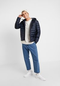 Calvin Klein - HOODED WADDED JACKET - Light jacket - blue - 1