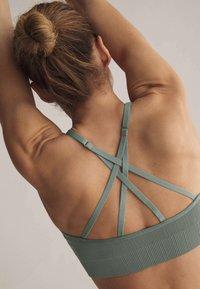 OYSHO - Light support sports bra - green - 5