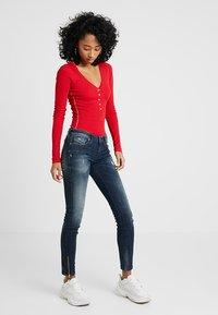 Diesel - SKINZEE LOW ZIP - Jeans Skinny Fit - indigo style exclusive - 1