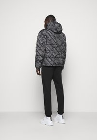 Versace Jeans Couture - QUILTED JACKET - Down jacket - nero - 2