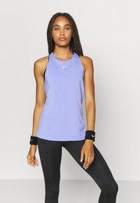 Nike Performance - TANK ALL OVER  - Camiseta de deporte - light thistle/white - 0