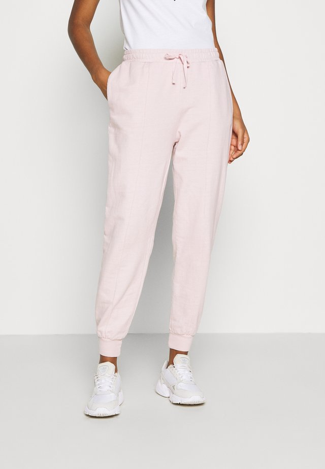 ACID WASH JOGGER - Trainingsbroek - pink