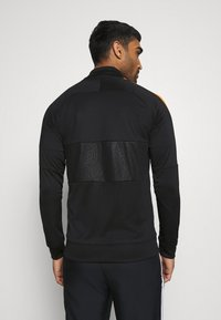 Nike Performance - AS ROM - Club wear - black/safety orange - 2