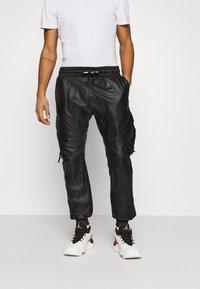 Tigha - TANO - Leather trousers - black - 0