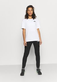 The North Face - INTERNATIONAL WOMENS DAY TEE - Print T-shirt - white - 1