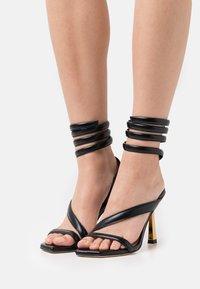 Stuart Weitzman - BEATRIX WRAP - Sandals - black/gold - 0