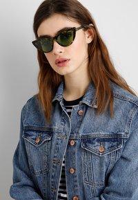 VOGUE Eyewear - GIGI HADID - Solbriller - brown - 1