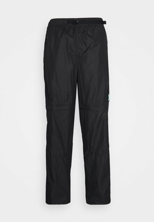 TRACK PANT - Tracksuit bottoms - black/university gold
