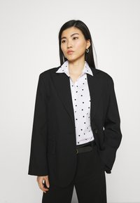 Marks & Spencer London - SPOT FITTED - Button-down blouse - offwhite - 2