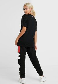 Fila Petite - PURE TEE - Print T-shirt - black - 2